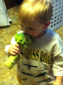 Elliot eating Broccoli